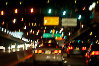 Heavy blurred traffic city bridge.