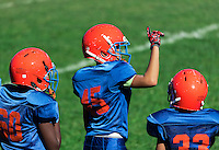 Young boys on the sideline of a Pop Warner football game, USA