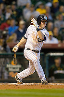 Brock Holt #7 of the Rice Owls follows through on his swing versus the Baylor Bears in the 2009 Houston College Classic at Minute Maid Park March 1, 2009 in Houston, TX.  The Owls defeated the Bears 8-3. (Photo by Brian Westerholt / Four Seam Images)