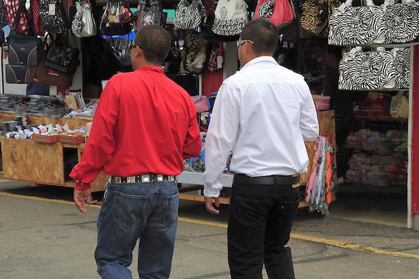 Two macho Hispanic men walk in Denver, Colorado. .  John offers private photo tours in Denver, Boulder and throughout Colorado. Year-round Colorado photo tours.