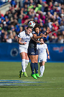 Cary, North Carolina - Sunday December 6, 2015: Ashton Miller (4) of the Duke Blue Devils battles for a jump ball with Raquel Rodriguez (11) during first half action at the 2015 NCAA Women's College Cup at WakeMed Soccer Park.  The Nittany Lions defeated the Blue Devils 1-0.
