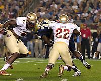 Florida State cornerback Nick Waisome (6) and linebacker Telvin Smith (22) tackle Pitt running back Isaac Bennett (34). Florida State. defeated Pitt 41-13 at Heinz Field on September 2, 2013.