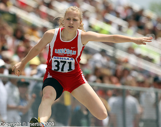 RAPID CITY, SD - MAY 30:  Nevada Sorenson of Lincoln wins the girls Class AA 300 meter hurdle finals during the 2009 South Dakota State Track Meet Saturday in Rapid City. (Photo by Dave Eggen/Inertia)