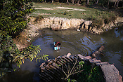A villager washes himself in a small pond in Shahpara village in Panchal block of Howrah district in West Bengal, India.<br /> Rukhsar Khatoon, India's last child in India paralysed by polio lives in this village.