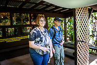 Tourists under the shelter of a covered photo exhibit at the Hawaii Tropical Botanical Garden, Papa'ikou, Big Island of Hawaiʻi.
