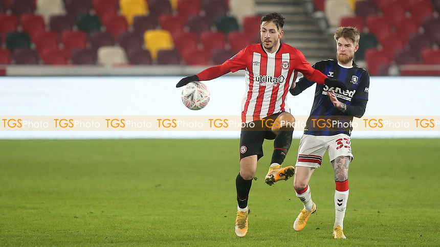 Halil Dervisoglu of Brentford controls the ball under pressure from Middlesbrough's Hayden Coulson during Brentford vs Middlesbrough, Emirates FA Cup Football at the Brentford Community Stadium on 9th January 2021