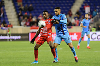 HARRISON, NJ - FEBRUARY 26: Omar Browne #99 of AD San Carlos is marked by Alexander Callens #6 of NYCFC during a game between AD San Carlos and NYCFC at Red Bull on February 26, 2020 in Harrison, New Jersey.