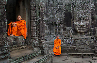 Angkor, Cambodia <br /> When first returning to Angkor Wat in Cambodia after twelve years I was initially dismayed to find the ancient ruins literally sinking under the weight of tourists. The last time I'd been on top of Thom Bakheng to watch the sunset I'd been alone with one other French tourist. Now bus loads of Korean and Japanese clamored up Bakheng Hill with an obsessive determination to join the crush of visitors resolute to capture the last rays of the day. I discovered it was possible to still find peace among the temples simply by circumambulating the ruins in the opposite direction of the tourists, such as these monks who came out to enjoy the quiet of the day at Bayon Temple.