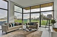 BNPS.co.uk (01202) 558833<br /> Pic: Savills/BNPS<br /> <br /> Big windows make the most of the views<br /> <br /> A striking high-tech eco home that would not look out of place in a Bond film is on the market for offers over £4m.<br /> <br /> Skyfall is a luxurious house in the Berkshire countryside designed to be totally carbon free.<br /> <br /> With its luxe white interiors, minimalist decor and stunning countryside surroundings, the five-bedroom property would fit effortlessly into 007's world.<br /> <br /> But it's the eco features of the brand new house, which is just outside the village of Taplow with Huntswood Golf Course next door, that make it really stand out.