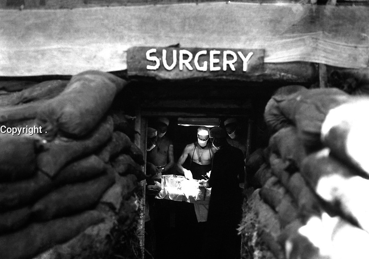 In an underground surgery room, behind the front lines on Bougainville, an American Army doctor operates on a U.S. soldier wounded by a Japanese sniper.  December 13, 1943.  Attributed to Miller. (Army)<br /> NARA FILE #:  111-SC-187247<br /> WAR & CONFLICT BOOK #:  918