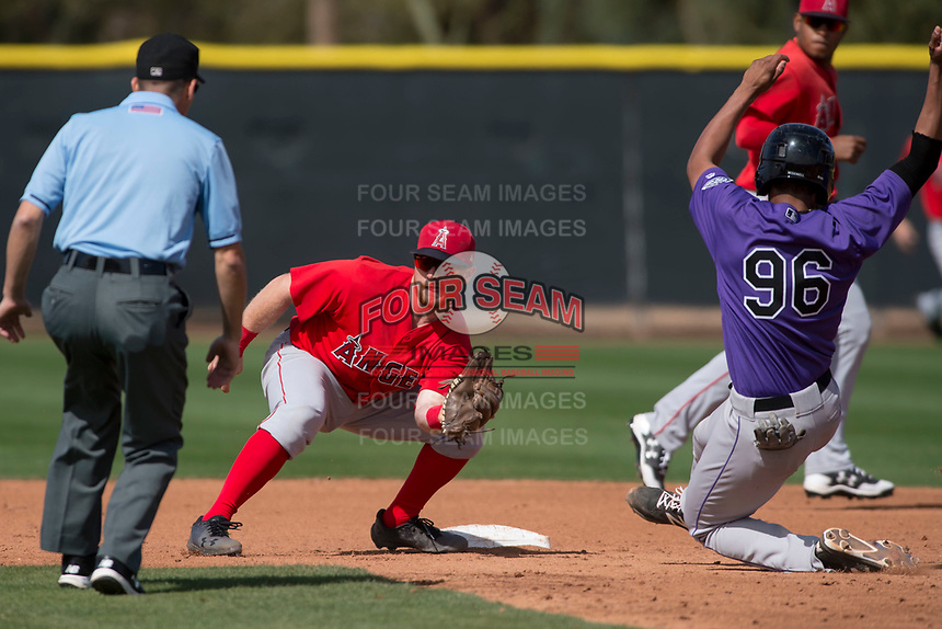 Los Angeles Angels second baseman Zane Gurwitz (71) prepares to apply the tag to Kennard McDowell (96) on a stolen base attempt during a Minor League Spring Training game against the Colorado Rockies at Tempe Diablo Stadium Complex on March 18, 2018 in Tempe, Arizona. (Zachary Lucy/Four Seam Images)