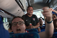 MEXICO CITY, MEXICO - June 11, 2017:  USA fans ride a bus to attend the World Cup Qualifier match against Mexico at Azteca Stadium.