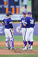 High Point Panthers starting pitcher Trevor Holloway (center) listens as head coach Craig Cozart (38) gives him instructions during game two of a double-header against the NJIT Highlanders at Williard Stadium on February 18, 2017 in High Point, North Carolina.  The Highlanders defeated the Panthers 4-2.  (Brian Westerholt/Four Seam Images)