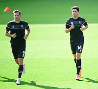 Lincoln City's Tom Hopper, left, and  Joe Walsh during the pre-match warm-up<br /> <br /> Photographer Chris Vaughan/CameraSport<br /> <br /> The EFL Sky Bet League One - Milton Keynes Dons v Lincoln City - Saturday 19th September 2020 - Stadium MK - Milton Keynes<br /> <br /> World Copyright © 2020 CameraSport. All rights reserved. 43 Linden Ave. Countesthorpe. Leicester. England. LE8 5PG - Tel: +44 (0) 116 277 4147 - admin@camerasport.com - www.camerasport.com