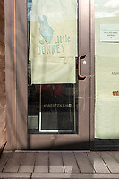 "Paper covers the windows of Little Donkey, a restaurant in Central Square in Cambridge, Massachusetts, on Mon., Jan. 4, 2021. A typewritten note on the door by Ken and Jamie reads, in part, ""This year has been the toughest of our careers...we have been fighting for our staff, their health, their well-being...Now we pivot again. Little Donkey will go into a 'hibernation' today in order to reopen the business on the other side."" A sign inside the doorway displays the hashtag #saverestaurants."