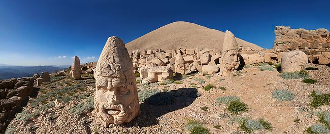 Statue head, from left, Antiochus, Commenge , Zeus, Apollo, Herekles & Eagle, in front of the 62 BC Royal Tomb of King Antiochus I Theos of Commagene, west Terrace, Mount Nemrut or Nemrud Dagi summit, near Adıyaman, Turkey