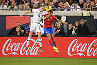 JACKSONVILLE, FL - NOVEMBER 10: Emily Sonnett #14 of the United States and Gabriela Guillen #2 of Costa Rica battle for a ball in the air during a game between Costa Rica and USWNT at TIAA Bank Field on November 10, 2019 in Jacksonville, Florida.