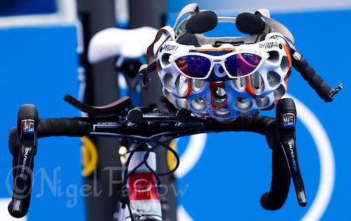 17 JUL 2011 - HAMBURG, GER - A competitors helmet and sunglasses sit on her bikes handlebars in transition before the start of the women's Hamburg round of triathlon's ITU World Championship Series (PHOTO (C) NIGEL FARROW)