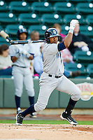 Geulin Beltre (29) of the Wilmington Blue Rocks follows through on his swing against the Winston-Salem Dash at BB&T Ballpark on April 20, 2013 in Winston-Salem, North Carolina.  The Dash defeated the Blue Rocks 4-2 in game one of a double-header.  (Brian Westerholt/Four Seam Images)
