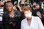 """Cannes Film Festival 2021 . 74th edition of the 'Festival International du Film de Cannes' under Covid-19 outbreak on 09/07/2021 in Cannes, France. Arrival for the screening of the film """"Benedetta"""". French Culture minister Roselyne Bachelot (r) and Congolese-French rapper Dadju."""
