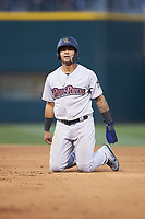 Gleyber Torres (7) of the Scranton/Wilkes-Barre RailRiders kneels on the ground after having been picked off of first base during the game against the Charlotte Knights at BB&T BallPark on April 12, 2018 in Charlotte, North Carolina.  The RailRiders defeated the Knights 11-1.  (Brian Westerholt/Four Seam Images)