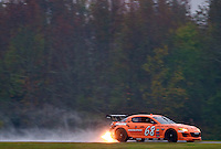 The #68 Mazda of Jonathan Bomarito and Sylvain Tremblay races past fall foliage in the rain during the Grand-Am Rolex Series test at Virginia International Raceway, Alton, VA , October 2010. (Photo by Brian Cleary/www.bcpix.com)