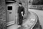 1970s Britain UK. Village life 1975 Newspaper delivery man, Mr Percy Howse Sunday morning. The Cotswolds. Lower and Upper Slaughter are twin villages on the River Eye and are know as The Slaughters.  1975