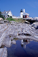 lighthouse, Maine, Pemaquid Point, Bristol, ME, Pemaquid Head Light reflects in a pool of water along the rocky coast of the Atlantic Ocean.
