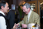 © Joel Goodman - 07973 332324 . 24/04/2014 . Knutsford , UK . UKIP leader NIGEL FARAGE on a walkabout tour of Knutsford on the European election campaign trail is given a free drink by a waiter in a restaurant . Farage has come under fire in recent days over a controversial UKIP billboard campaign . Photo credit : Joel Goodman