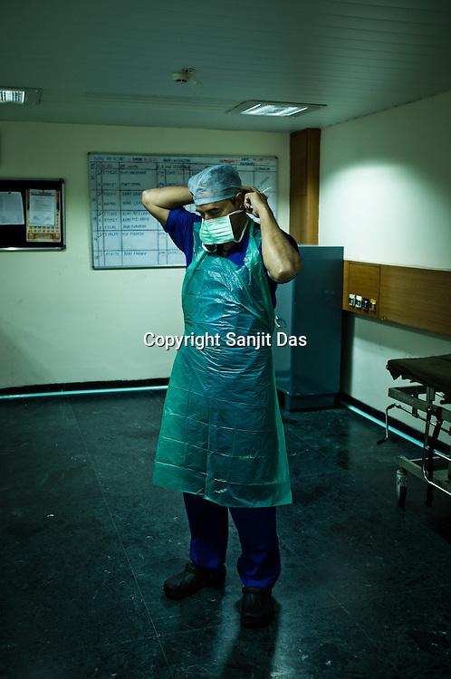 58 year old heart surgeon, Dr. Devi Prasad Shetty gets ready for an open heart surgery at the Narayana Hrudayalaya in Bangalore, Karnataka, India. Photo: Sanjit Das/Panos