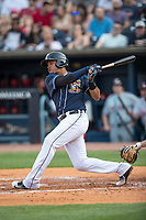 Toledo Mud Hens designated hitter Efren Navaro (17) follows through on his swing against the Louisville Bats during the International League baseball game on May 17, 2017 at Fifth Third Field in Toledo, Ohio. Toledo defeated Louisville 16-2. (Andrew Woolley/Four Seam Images)
