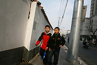 CHINA. Shanghai. Schoolchildren in the old town. Shanghai is a sprawling metropolis or 15 million people situated in south-east China. It is regarded as the country's showcase in development and modernity in modern China. This rapid development and modernization, never seen before on such a scale has however spawned countless environmental and social problems. 2008