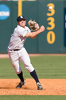Rice Owls third baseman Shane Hoelscher #2 throws the ball to first against the Memphis TIgers in NCAA Conference USA baseball on May 14, 2011 at Reckling Park in Houston, Texas. (Photo by Andrew Woolley / Four Seam Images)