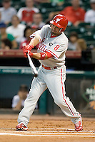 Philadelphia Phillies outfielder Shane Victorino #8 swings during the Major League Baseball game against the Houston Astros at Minute Maid Park in Houston, Texas on September 12, 2011. Houston defeated Philadelphia 5-1.  (Andrew Woolley/Four Seam Images)