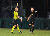 LAKE BUENA VISTA, FL - JULY 18: Eduard Atuesta #20 of LAFC reacts to a yellow card given to him by the referee during a game between Los Angeles Galaxy and Los Angeles FC at ESPN Wide World of Sports on July 18, 2020 in Lake Buena Vista, Florida.