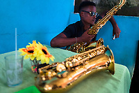 An Afro-Colombian saxophone player waits for the start of a music show during the San Pacho festival in Quibdó, Colombia, 30 September 2019. Every year at the turn of September and October, the capital of the Pacific region of Chocó holds the celebrations in honor of Saint Francis of Assisi (locally named as San Pacho), recognized as Intangible Cultural Heritage by UNESCO. Each day carnival groups, wearing bright colorful costumes and representing each neighborhood, dance throughout the city, supported by brass bands playing live music. The festival culminates in a traditional boat ride on the Atrato River, followed by massive religious processions, which accent the pillars of Afro-Colombian's identity – the Catholic devotion grown from African roots.
