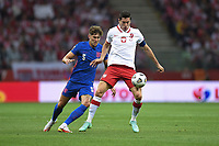 8th September 2021; PGE National Stadium, Warsaw, Poland: FIFA World Cup 2022 Football qualification, Poland versus England;  Josh Stones challenges Robert Lewandowski