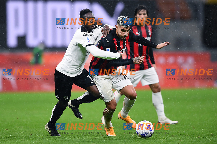Emanuel Gyasi of Spexia Calcio and Theo Hernandez of AC Milan compete for the ball during the Serie A football match between AC Milan and Spezia Calcio at San Siro Stadium in Milano  (Italy), October 4th, 2020. Photo Image Sport / Insidefoto