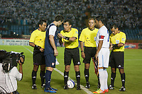 The USA' s Carlos Bocanegra and Guatemala's Carlos Ruiz take part in the coin toss from referee Joel Aguilar before the United States played Guatemala at Estadio Mateo Flores in Guatemala City, Guatemala in a World Cup Qualifier on Tue. June 12, 2012.