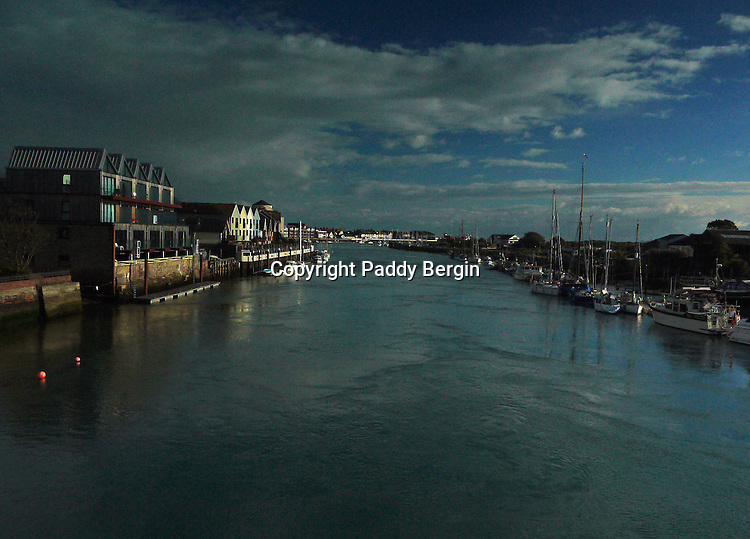 A late afternoon view looking South to the mouth of the River Arun, Littlehampton, West Sussex.<br /> <br /> Stock Photo by Paddy Bergin