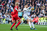 Cristiano Ronaldo (r) of Real Madrid fights for the ball with Simon Kjaer of Sevilla FC during the La Liga 2017-18 match between Real Madrid and Sevilla FC at Santiago Bernabeu Stadium on 09 December 2017 in Madrid, Spain. Photo by Diego Souto / Power Sport Images
