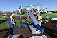BATTER UP <br />Darrell Newton (left) and Hasley (cq) Gilbert build at movable batting cage on Tuesday Jan. 12 2021 at the new baseball stadium at Heritage High School in Rogers. New baseball and softball stadiums are nearly finished at Heritage and Rogers High School. They'll be ready for play this spring, said Keith Kilgore, Rogers School District athletic director. Go to nwonline.com/210113Daily/ to see more photos.<br />(NWA Democrat-Gazette/Flip Putthoff)