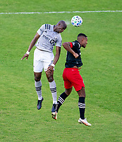 WASHINGTON, DC - NOVEMBER 8: Rod Fanni #7 of the Montreal Impact goes up for a header with Ola Kamara #9 of D.C. United during a game between Montreal Impact and D.C. United at Audi Field on November 8, 2020 in Washington, DC.