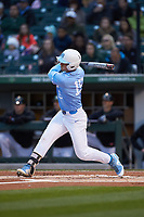 Michael Busch (15) of the North Carolina Tar Heels follows through on his swing against the Charlotte 49ers at BB&T BallPark on March 27, 2018 in Charlotte, North Carolina. The Tar Heels defeated the 49ers 14-2. (Brian Westerholt/Four Seam Images)