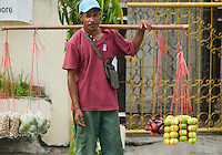Street vendor offers fruit for sale in Dili, Timor-Leste (East Timor)