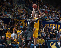 Ricky Kreklow of California shoots the ball during 2014 National Invitation Tournament against Arkansas at Haas Pavilion in Berkeley, California on March 24th, 2014.  California defeated Arkansas, 75-64.