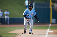 Isaias Quiroz (22) of the Hickory Crawdads takes his lead off of third base against the Winston-Salem Dash at Truist Stadium on July 10, 2021 in Winston-Salem, North Carolina. (Brian Westerholt/Four Seam Images)