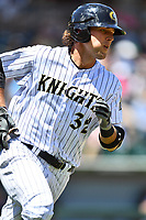 Charlotte Knights catcher Kevan Smith (32) runs to first base during a game against the  Gwinnett Braves at BB&T Ballpark on May 7, 2017 in Charlotte, North Carolina. The Knights defeated the Braves 7-1. (Tony Farlow/Four Seam Images)