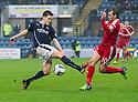 Dundee's Thomas Konrad challenges Aberdeen's Niall McGinn for the ball.