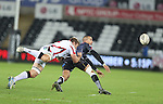 Ospreys wing Eli Walker gets his pass away as Ulster number 8 Roger Wilson dives in to make the tackle.<br /> Guiness Pro12<br /> Ospreys v Ulster<br /> 20.12.14<br /> ©Steve Pope -SPORTINGWALES